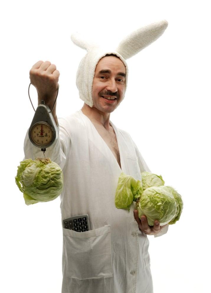 Man weighing lettuce stock photo
